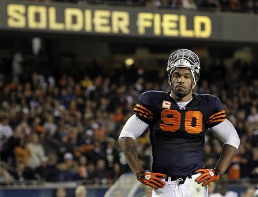 """FILE - In this Sept. 27, 2010, file photo, Chicago Bears' Julius Peppers looks on during the second half of an NFL football game against the Green Bay Packers in Chicago. In a conference call on Wednesday, Oct. 6, 2010, with reporters ahead of Peppers' return to Charlotte on Sunday with the Bears, the five-time Pro Bowl defensive end said he was under the impression the Panthers decided to """"do away with anybody who is making a significant amount of money"""" as part of a roster overhaul that's produced the NFL's youngest team. (AP Photo/Charles Rex Arbogast, File)"""