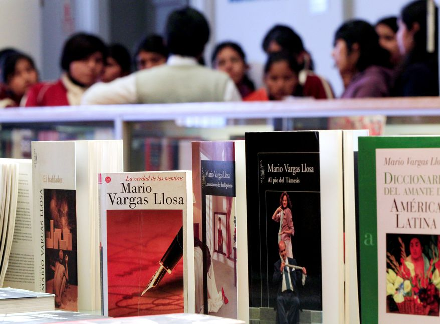 """Books by Mario Vargas Llosa are displayed at a public library in Lima, Peru. The Swedish Academy said it honored the 74-year-old author """"for his cartography of structures of power and his trenchant images of the individual's resistance, revolt and defeat."""" (Associated Press)"""