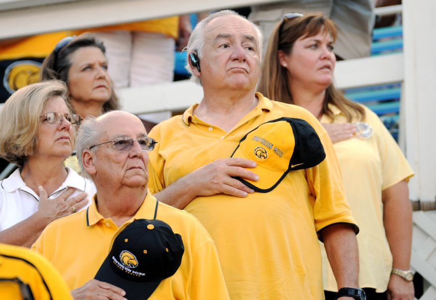 Southern Mississippi fans stand for the pledge of allegiance during the pre-game activities of a NCAA college football game Saturday, Sept. 11, 2010 in Hattiesburg, Miss. against Prairie View. (AP Photo/Steve Coleman)