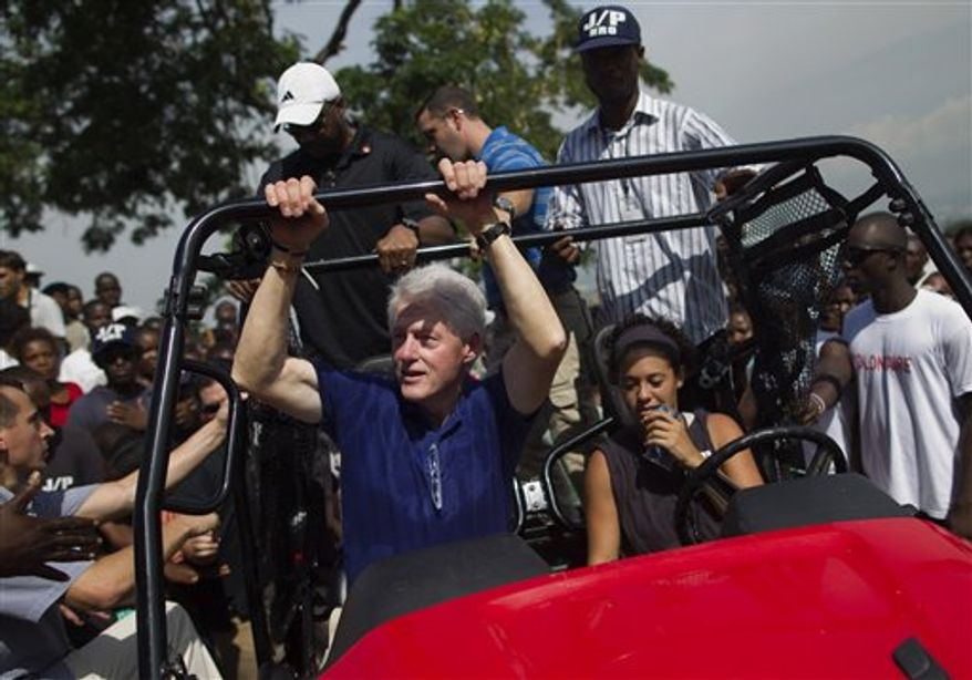 Former president and UN special envoy to Haiti, Bill Clinton, arrives to visit people who were displaced by the earthquake at the Petionville Golf Club that is being used as a camp for the displaced in Port-au-Prince, Haiti, Wednesday Oct. 6, 2010. (AP Photo/Ramon Espinosa)