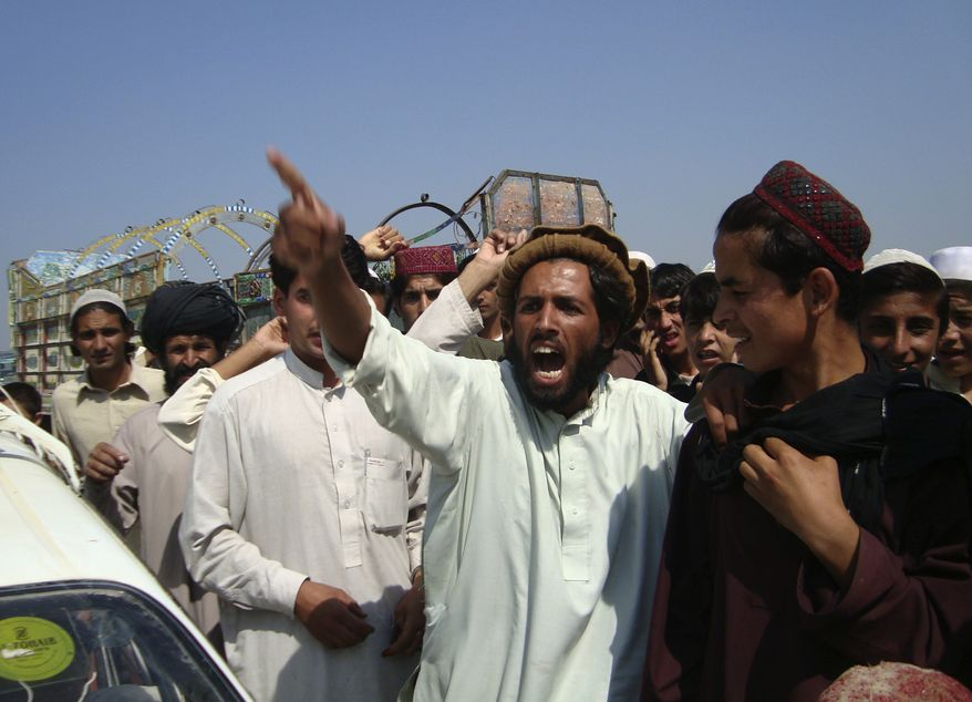 Afghans shout anti-American slogans during a protest in Khost, east of Kabul, Afghanistan, Friday, Oct. 8, 2010. Firing from NATO helicopters in an eastern province Friday killed six Afghan militiamen who purportedly shot at the aircraft, an Afghan official said. (AP Photo/Nashanuddin Khan)
