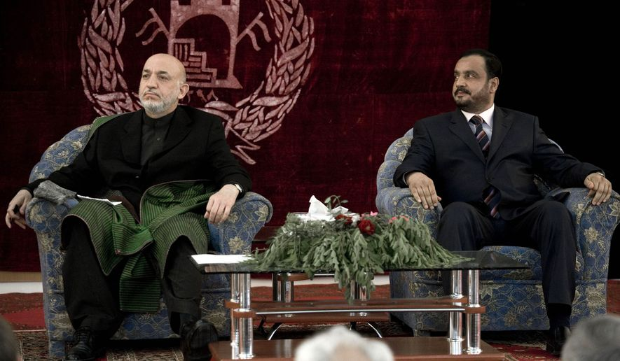 In this photo taken on April 12, 2010, Afghan President Hamid Karzai, left, and Kunduz Gov. Mohammed Omar attend a meeting with elders in Kunduz, Afghanistan. Mr. Omar was among many killed in a bomb blast at a mosque in Takhar province Friday, Oct. 8, 2010. (AP Photo/Dusan Vranic)