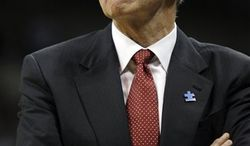 FILE - In this March 7, 2009, file photo,  Connecticut coach Jim Calhoun reacts during the second half of an NCAA college basketball game against Pittsburgh in Pittsburgh. The University Connecticut says its men's basketball program committed major NCAA recruiting violations. The school imposed its own sanctions, including two years' probation and a loss of one scholarship for the next two seasons. But the university says the evidence does not support the NCAA allegation that coach Jim Calhoun _ who has won two national titles with the Huskies _ failed to promote an atmosphere for compliance. (AP Photo/Carolyn Kaster, File)
