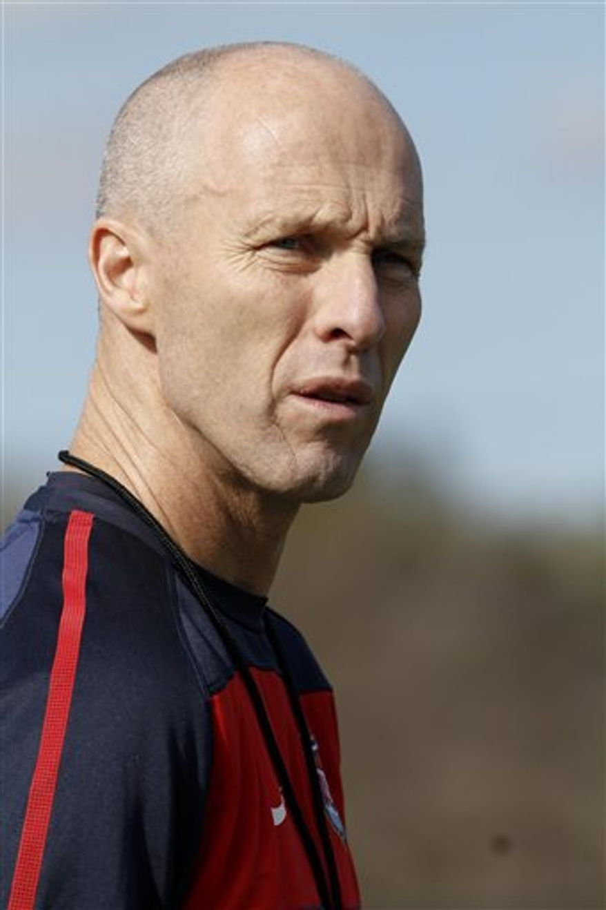 Bob Bradley, coach of the U.S. men's soccer team, watches practice Monday, Oct. 4, 2010, in Bridgeview, Ill., before the team's exhibition match with Poland on Saturday night. (AP Photo/Charles Cherney)