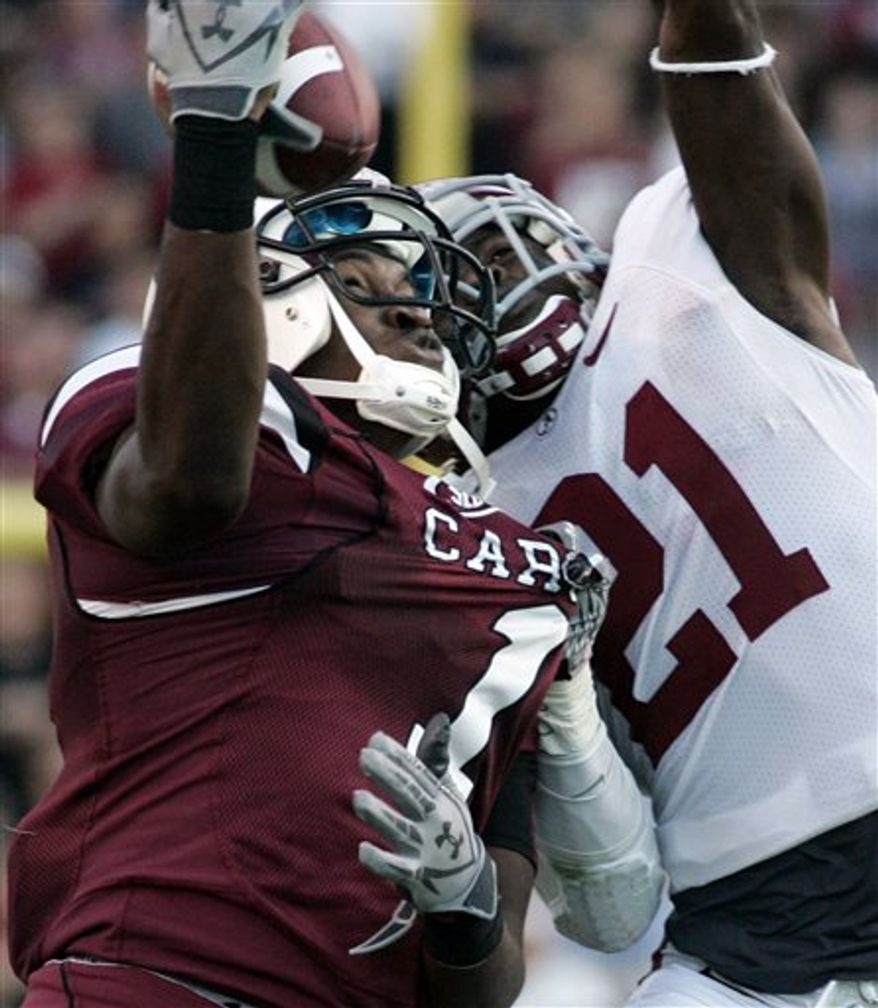 South Carolina's Alshon Jeffery, left,  makes a one handed catch as Alabama's Dre Kickpatrick (21) defends during the second half of an NCAA college football game Saturday, Oct. 9, 2010, at Williams Brice Stadium in Columbia, S.C. (AP Photo/Mary Ann Chastain)