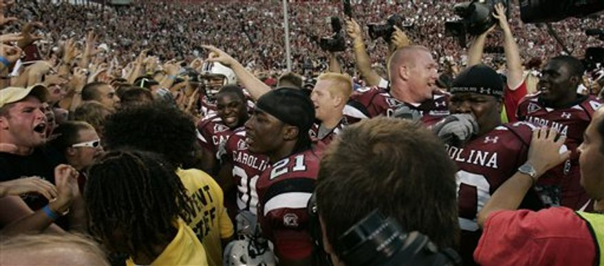 South Carolina fan holds up his sign as they defeat Alabama 35-21 in an NCAA college football game, Saturday, Oct. 9, 2010, at Williams Brice Stadium in Columbia, S.C. (AP Photo/Mary Ann Chastain)
