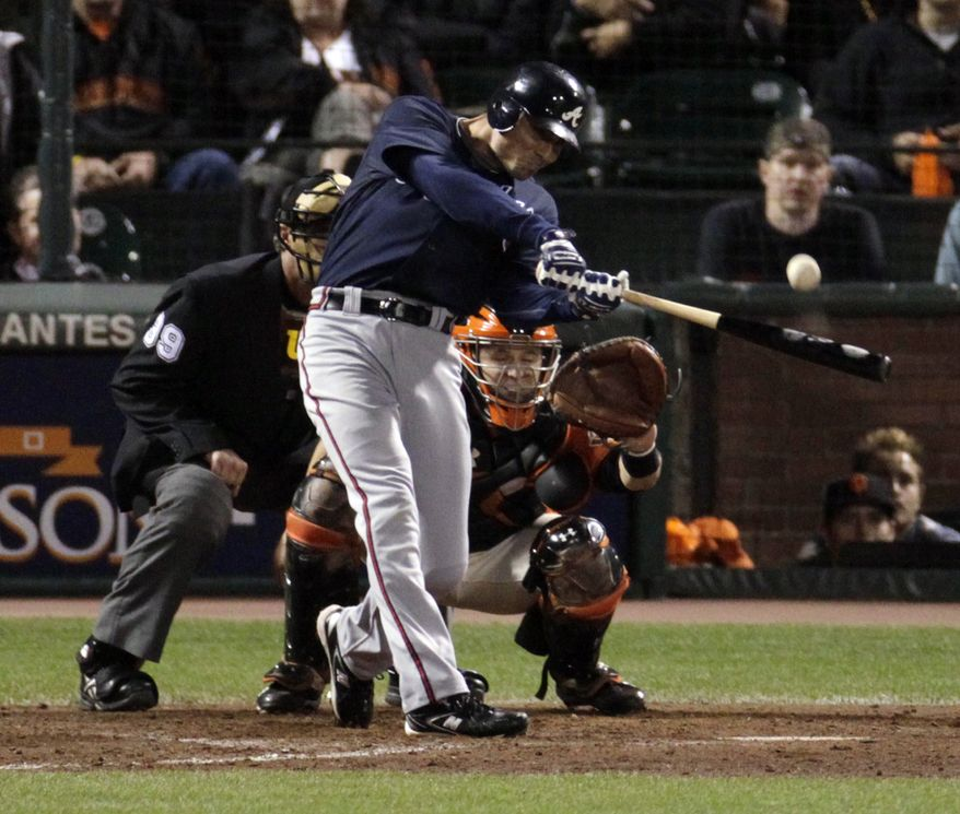 Atlanta Braves Rick Ankiel hits a solo home run in the eleventh inning of Game 2 of the National League Division Series baseball game against the San Francisco Giants in San Francisco on Friday, Oct. 8, 2010. The Braves beat the Giants 5-4 in eleven innings. (AP Photo/Jeff Chiu)