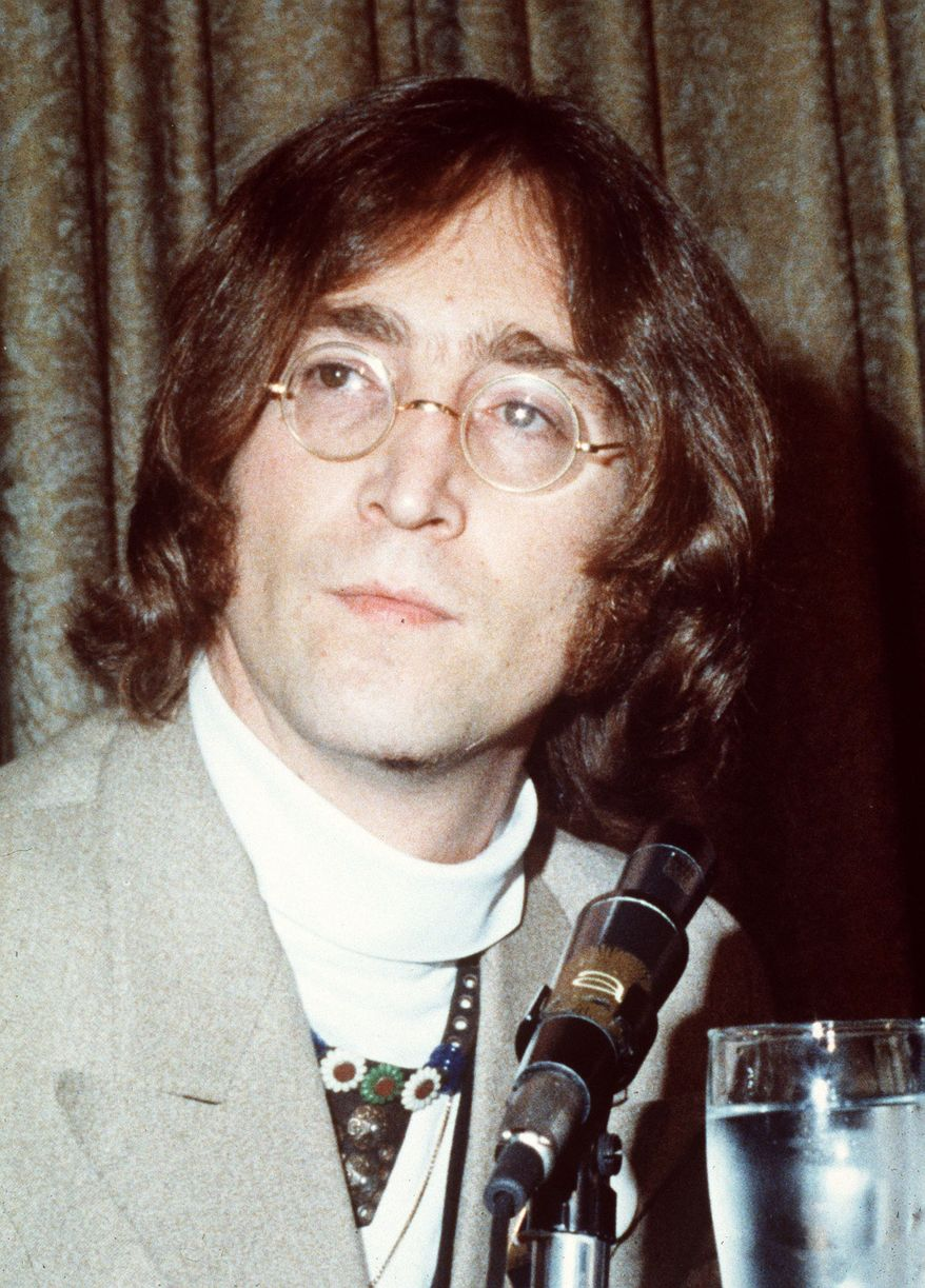 ** FILE ** This undated file photo shows John Lennon. It's hard to imagine which event sounds more implausible: John Lennon's 70th birthday, Saturday, Oct. 9, 1940; or the 30th anniversary of his murder -- Dec. 8, 1980. (AP Photo, file)