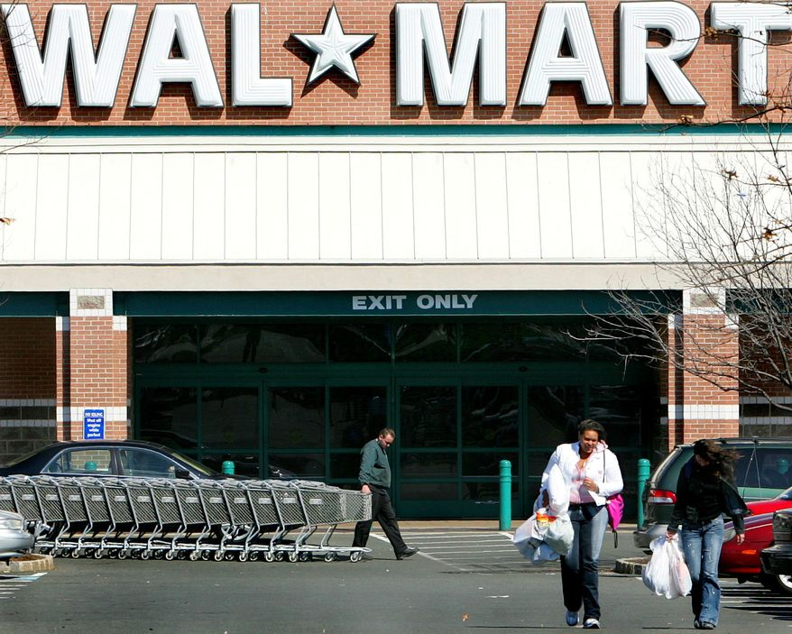 ** FILE ** In this March 14, 2006, file photo, the Wal-Mart store in Princeton, N.J., is seen. Wal-Mart Stores Inc., the nation's largest private employer, plans to end automatic profit-sharing contributions for its employees in a revamp of its benefits package that it says will give workers more chance to share in its financial success. (AP Photo/Jose F. Moreno, File)