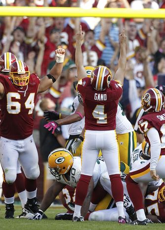 ASSOCIATED PRESS Washington Redskins' Graham Gano (4) celebrates his game-wining field goal during overtime in an NFL football game against the Green Bay Packers in Landover, Md., Sunday, Oct. 10, 2010. Washington won 16-13.