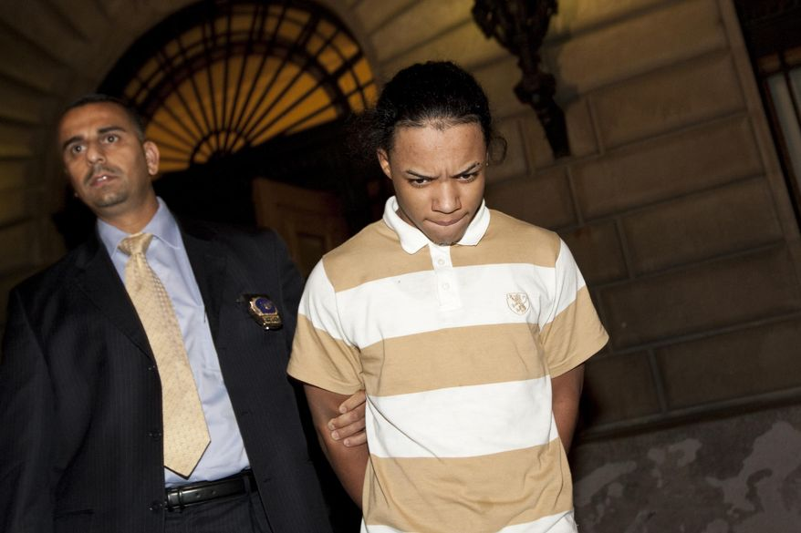 Brian Cepeda (right), 16, and eight others face charges including robbery, assault and unlawful imprisonment as hate crimes in the torture of two teenage boys and a man in an anti-gay attack last week. (AP Photo/Uli Seit)