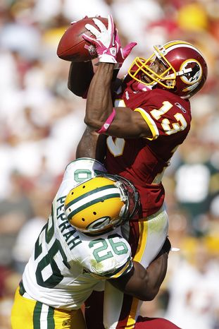 ASSOCIATED PRESS Washington Redskins wide receiver Anthony Armstrong pulls in a touchdown pass under pressure from Green Bay Packers safety Charlie Peprah during the second half of an NFL football game in Landover, Md., Sunday, Oct. 10, 2010.