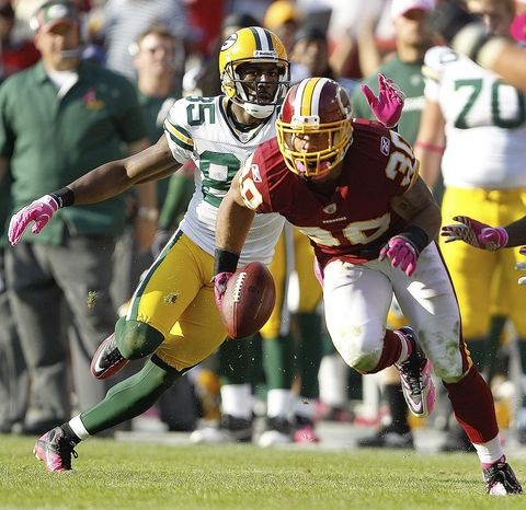 ASSOCIATED PRESS Washington Redskins  safety LaRon Landry intercepts a pass intended for Green Bay Packers wide receiver Greg Jennings, left, during overtime in an NFL football game in Landover, Md., Sunday, Oct. 10, 2010. Washington won 16