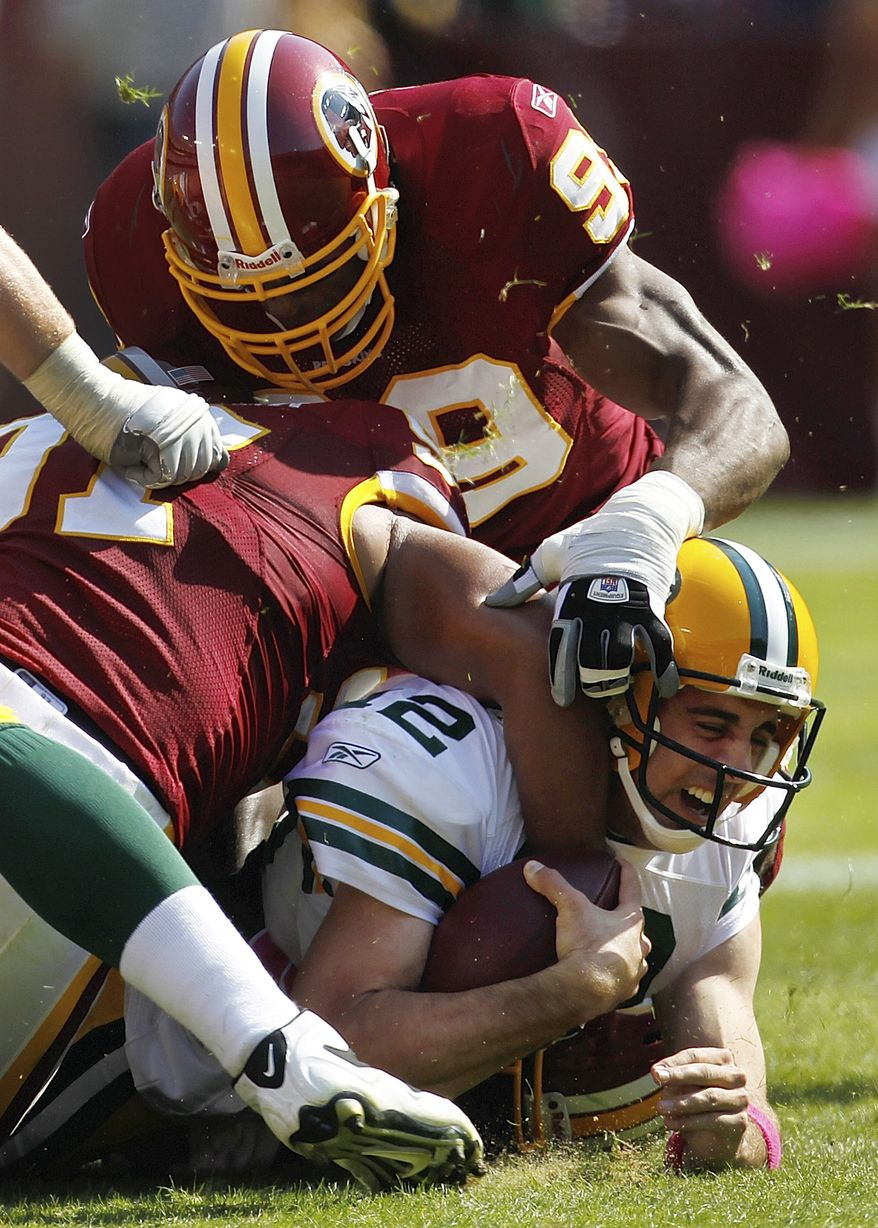 ASSOCIATED PRESS Washington Redskins  linebackers Lorenzo Alexander, left, and Andre Carter sack Green Bay Packers quarterback Aaron Rodgers during the first half of an NFL football game in Landover, Md., Sunday, Oct. 10, 2010. Washington won 16-13 in overtime.