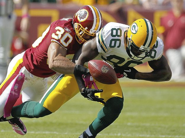ASSOCIATED PRESS Washington Redskins  safety LaRon Landry forces a fumble from Green Bay Packers tight end Donald Lee during the first half of an NFL football game in Landover, Md., Sunday, Oct. 10, 2010. Washington recovered the fumble.