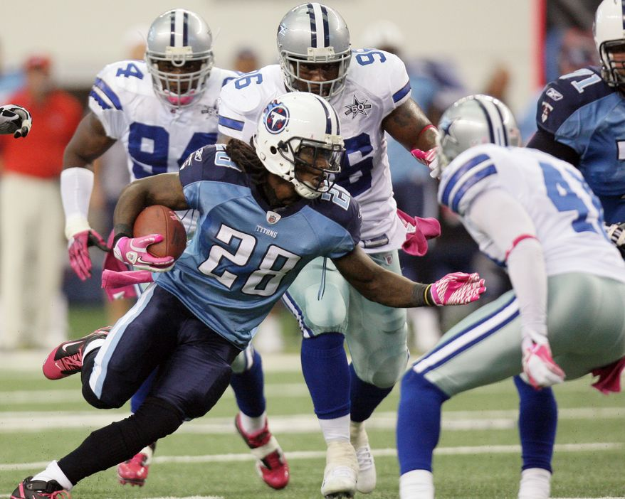 ASSOCIATED PRESS Tennessee Titans  running back Chris Johnson (28) runs against the Dallas Cowboys defense during the first half of an NFL football game Sunday, Oct. 10, 2010, in Arlington, Texas.