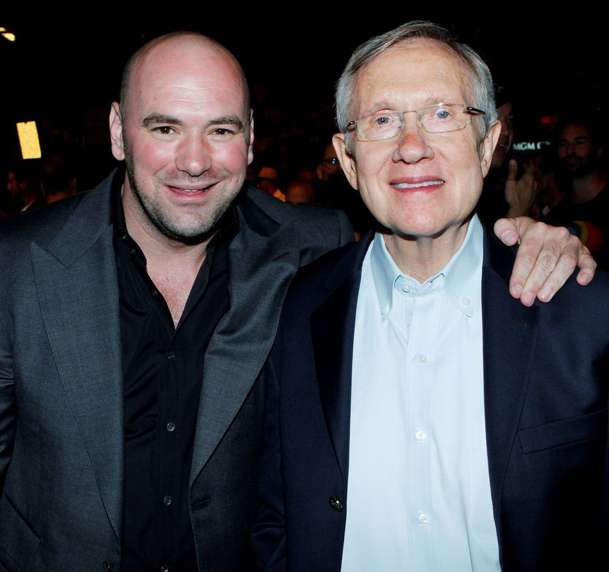 Associated Press Ultimate Fighting Championship President Dana White (left) poses with Sen. Harry Reid, Nevada Democrat, at a UFC event near Las Vegas in July. A longtime boxing fan, Mr. Reid is thought to be the sport's most powerful political ally.