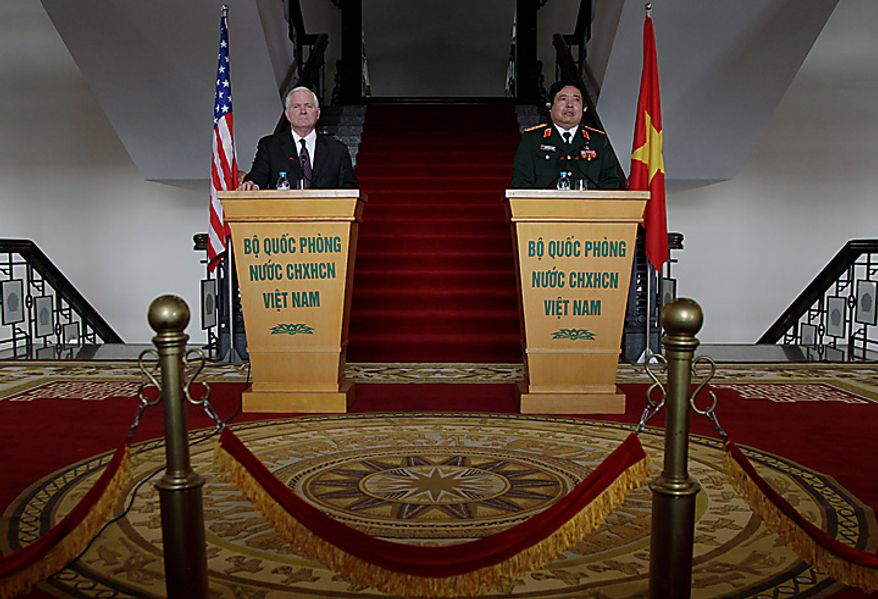 Defense Secretary Robert Gates, left, and Vietnam's Minister of Defense General Phung Quang Thanh hold a press conference at the Vietnam Ministry of Defense in Hanoi, Vietnam, Monday, Oct. 11, 2010.  (AP Photo/Carolyn Kaster, Pool)