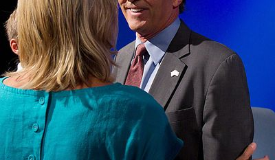 Maryland gubernatorial candidate former Republican Gov. Robert Ehrlich talks with his wife Kendel, left, after taking part in a debate against Democratic incumbent Gov. Martin O'Malley, Monday, Oct. 11, 2010, in Baltimore. (AP Photo/Rob Carr)