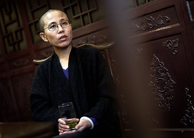 In this Sept. 28, 2010 file photo, Liu Xia, wife of Chinese dissident Liu Xiaobo, speaks during an interview in Beijing, China. Liu Xia, the wife of Nobel Peace Prize winner Liu Xiaobo,  said in a Twitter message that she had been under house arrest since Friday Oct. 8, 2010.  (AP Photo/Andy Wong/file)