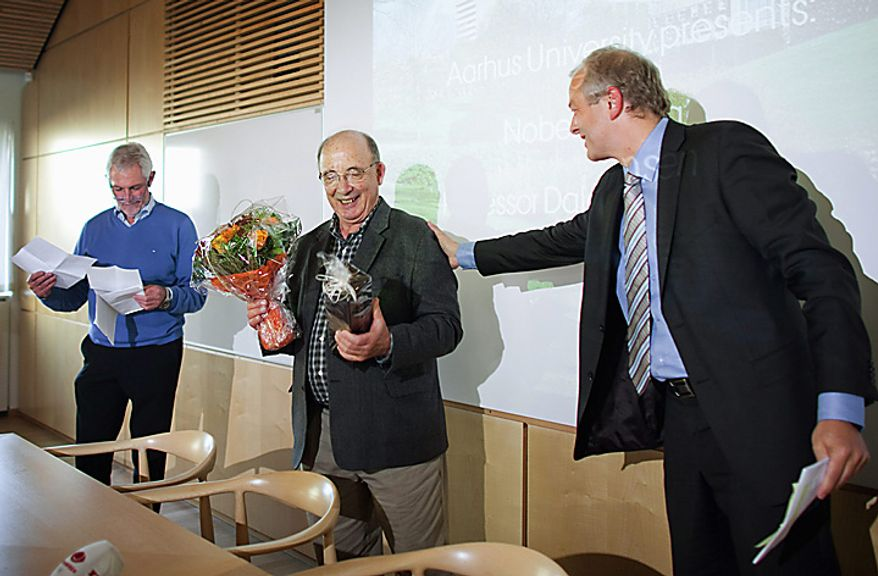 American economist Dale Mortensen, 71, centre, is welcomed to a press conference at the University of Aarhus, in Aarhus, Denmark, Monday Oct. 11, 2010. Prof. Mortensen, along with Christopher Pissarides and Peter Diamond, has been awarded the 2010 Nobel economics prize for developing a theory that helps explain why a lot of people can remain unemployed despite a large number of job vacancies. The three men were honored for their analysis of the friction involved when buyers and sellers are paired up in markets. Mortensen is from Northwestern University in Evanston, Ill., and is currently a visiting professor at the University of Aarhus. (AP Photo/Polfoto/ Andreas Szlavik)