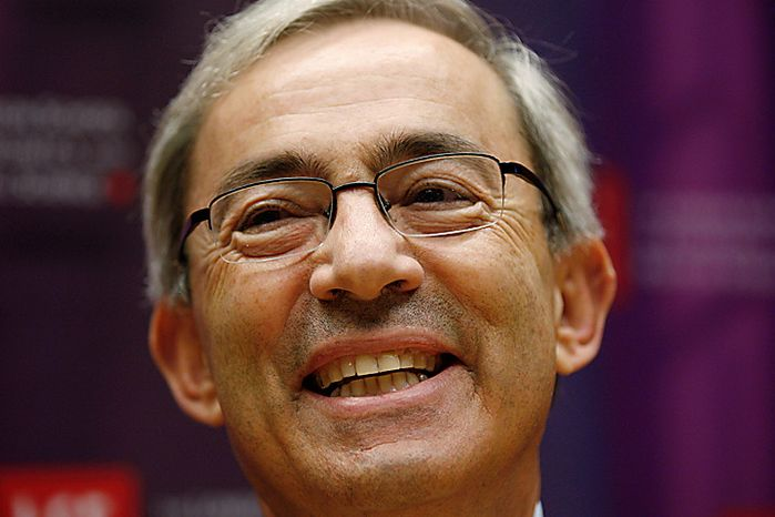 Professor Christopher Pissarides of the London School of Economics smiles as he speaks to the media in London Monday, Oct. 11, 2010, following his joint award for the Nobel Prize in Economic Sciences 2010.  The Nobel is awarded jointly to Americans Peter Diamond and Dale Mortensen, and British Cypriot Christopher Pissarides,  as joint winners for developing theories that help explain how economic policies can affect unemployment.(AP Photo/Sang Tan)
