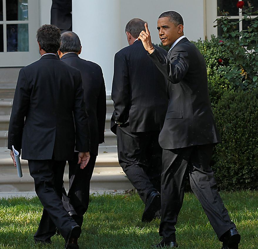 President Barack Obama points upwards as he walks back to the Oval Office after speaking to reporters in the Rose Garden to highlight a new report on the impact of his $50 billion infrastructure-investment proposal, Monday, Oct. 11, 2010 at the White House in Washington. Walking ahead of Obama are from left to right, Secretary of Treasury Timonthy Geithner, former Secretaries of Transportation Norman Mineta and Samuel Skinner. (AP Photo/Pablo Martinez Monsivais)