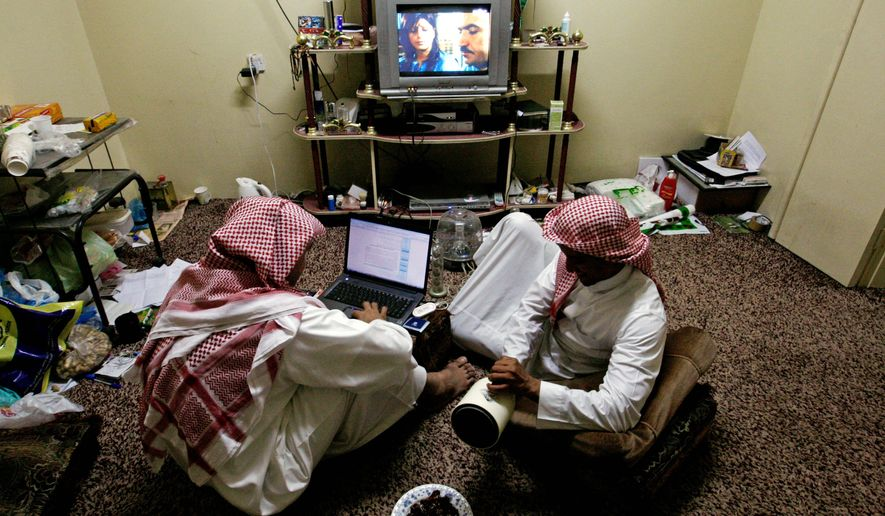 "Men watch satellite TV in Riyadh, Saudi Arabia, in September. A 2008 fatwa issued by the chief of the country's top court said it would be permissible to kill the owners of satellite networks that show ""immoral"" content. He was removed as chief. (Associated Press)"