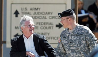 John Galligan (left), the defense attorney for Maj. Nidal Malik Hasan, leaves the U.S. Magistrate court where an Article 32 hearing for Maj. Hasan was being held on Tuesday in Fort Hood, Texas. (Associated Press)