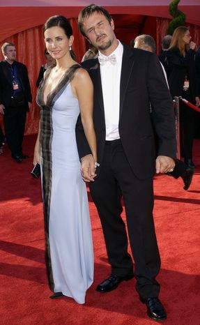 "** FILE ** In this Sept. 21, 2003, file photo, Courteney Cox Arquette, a star in the comedy series ""Friends,"" arrives with her husband David Arquette for the 55th Annual Primetime Emmy Awards at the Shrine Auditorium in Los Angeles. (AP Photos/Laura Rauch, file)"