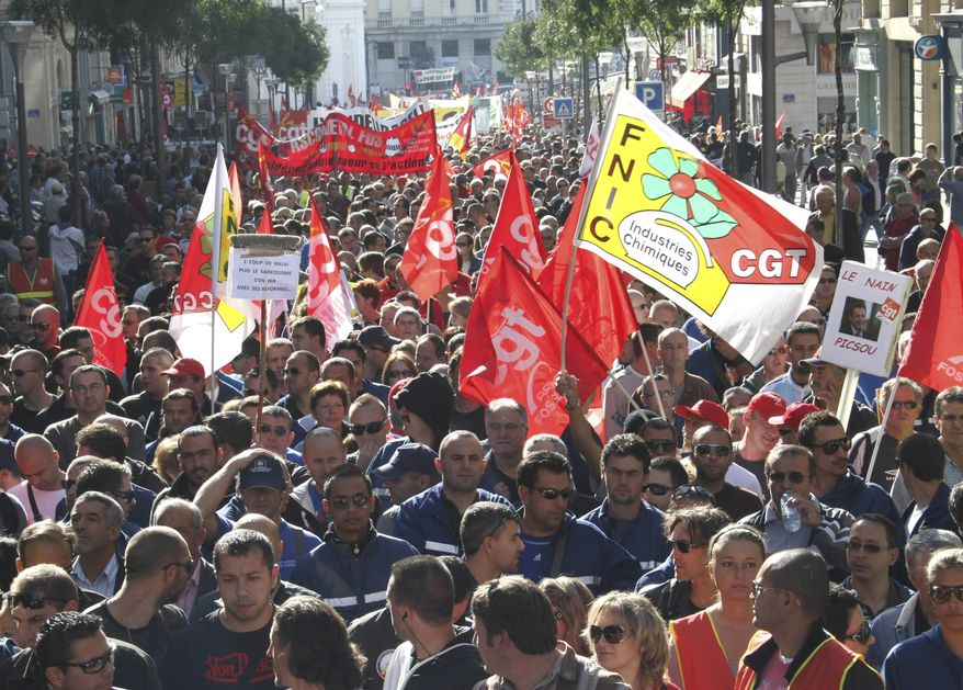 Workers take to the streets during a protest in Marseille, France, on Tuesday Oct.12, 2010. Teachers, mail carriers, bus drivers and other French workers tried to shut down France in a showdown with President Nicolas Sarkozy over his government's attempt to raise the retirement age by two years to save money. (AP Photo/Claude Paris)