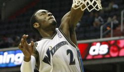 **FILE** Washington Wizards point guard John Wall goes to the basket during the fourth quarter of an NBA preseason basketball game against the Atlanta Hawks in Washington on Oct. 12, 2010. (Associated Press)