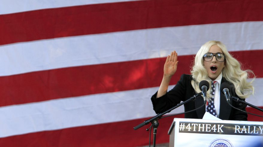 """Recording artist Lady Gaga speaks at a rally in support of repealing the so-called """"don't ask, don't tell"""" law, in Portland, Maine, on Monday, September 20, 2010. (AP Photo/Pat Wellenbach)"""