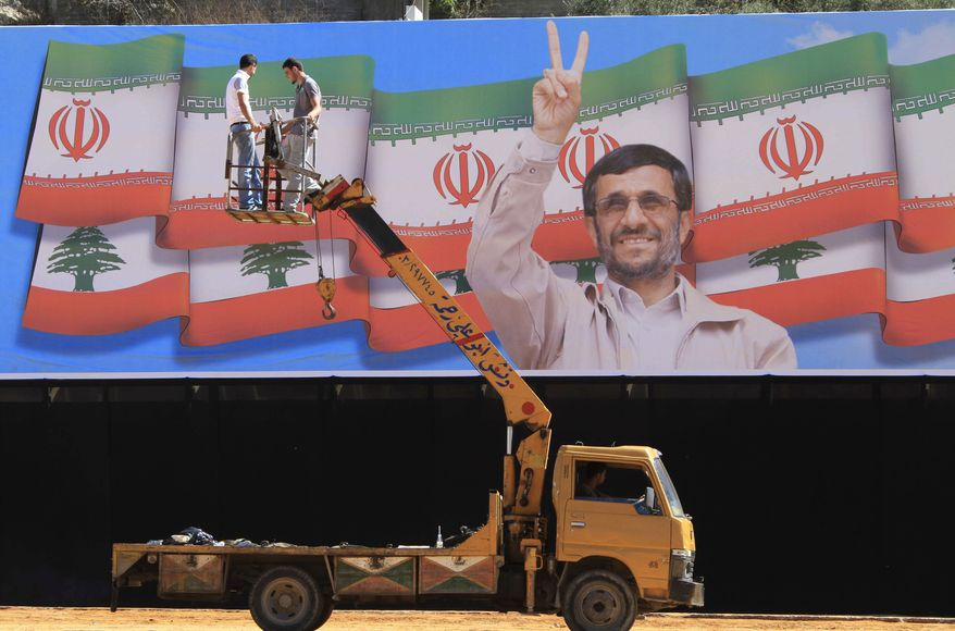 A giant poster of Iranian President Mahmoud Ahmadinejad is on display in the southern village of Bint Jbeil, Lebanon, on Tuesday, Oct. 12, 2010, in preparation for Mr. Ahmadinejad's visit there. (AP Photo/Mohammed Zaatari)