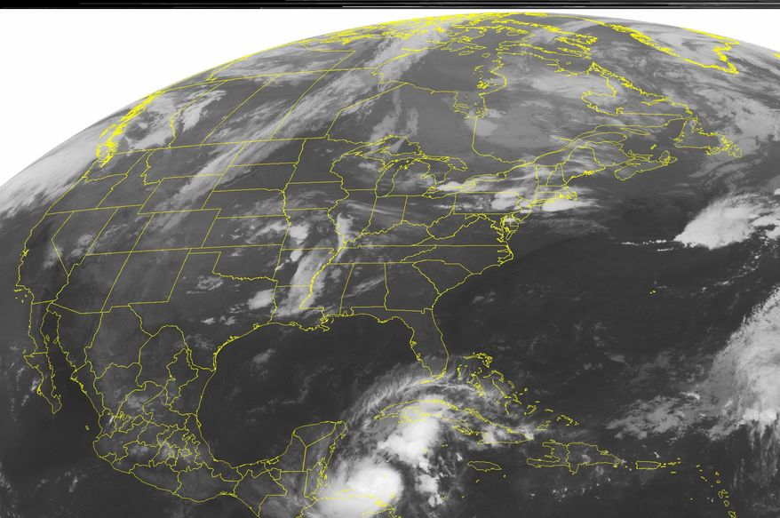 This NOAA satellite image taken Tuesday, October 12, 2010, at 1:00 a.m. EDT shows Tropical Storm Paula in the Caribbean Sea. (AP PHOTO/WEATHER UNDERGROUND)