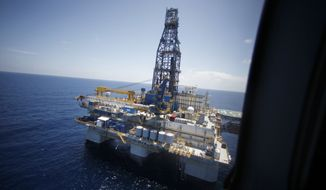 In a July 28, 2010, file photo, the deepwater rig Noble Danny Adkins is seen from Interior Secretary Ken Salazar's helicopter as he arrives to tour the rig in the Gulf of Mexico, off the coast of Louisiana. The Obama administration, under heavy pressure from the oil industry and others in the Gulf Coast, on Tuesday, Oct. 12 2010, lifted the moratorium on deep water drilling that it imposed in the wake of the disastrous BP oil spill. (AP Photo/Gerald Herbert, File)