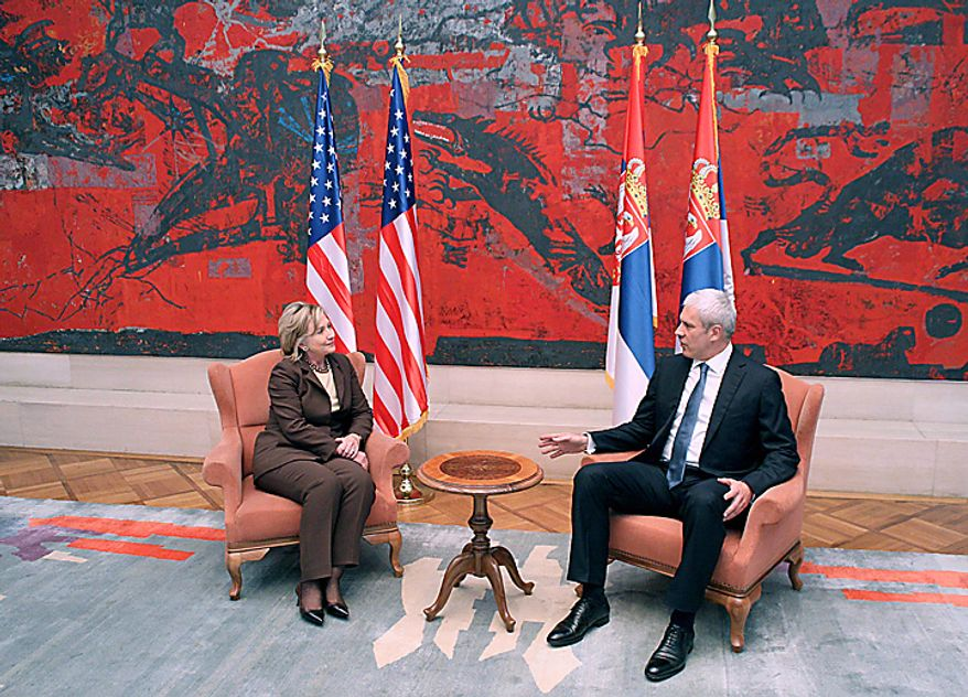Serbian President Boris Tadic, right, speaks with US Secretary of State Hillary Rodham Clinton, left, in Belgrade, Serbia, Tuesday, Oct. 12, 2010. Clinton has brought her message of reform and reconciliation in the Balkans to Serbia, urging the country to take steps to fully integrate itself with Europe. (AP Photo/Darko Vojinovic)