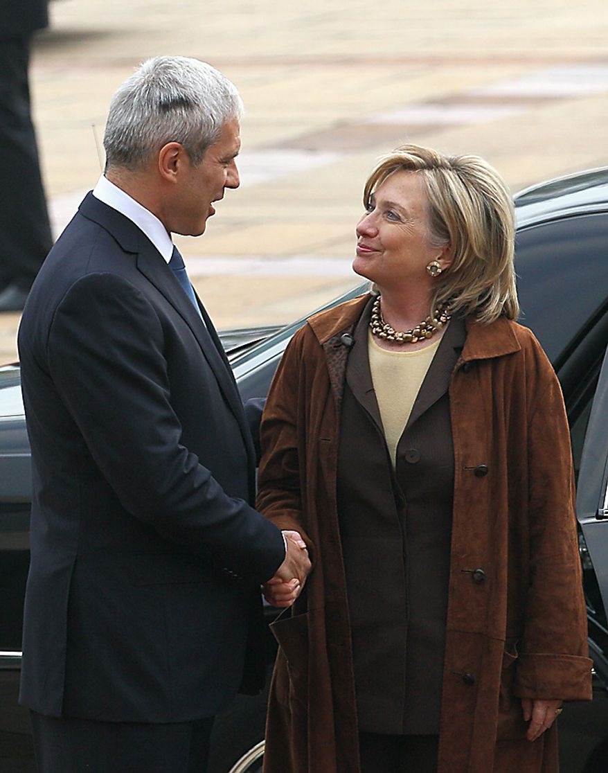 U.S. Secretary of State Hillary Rodham Clinton, right, shakes hands with Serbian President Boris Tadic, in Belgrade, Serbia, Tuesday, Oct. 12, 2010. Clinton on Tuesday challenged all sides in ethnically divided Bosnia to embrace political reform needed for European Union and NATO membership. (AP Photo/Darko Vojinovic)