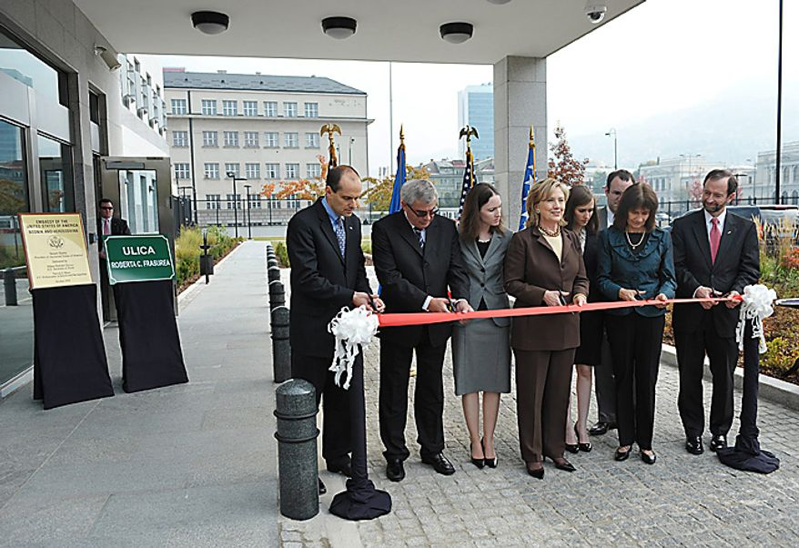US Secretary of State Hillary Rodham Clinton, center,  takes part in a ribbon-cutting ceremony during the dedication of the new US Embassy compound, Tuesday Oct. 12, 2010 in Sarajevo. Secretary Clinton arrived late on Monday, in the capital of ethnically divided Bosnia-Herzegovina, which just held elections, to urge the country's new leadership to make EU membership a priority. Others are unidentified. (AP Photo/Mandel Ngan, Pool)
