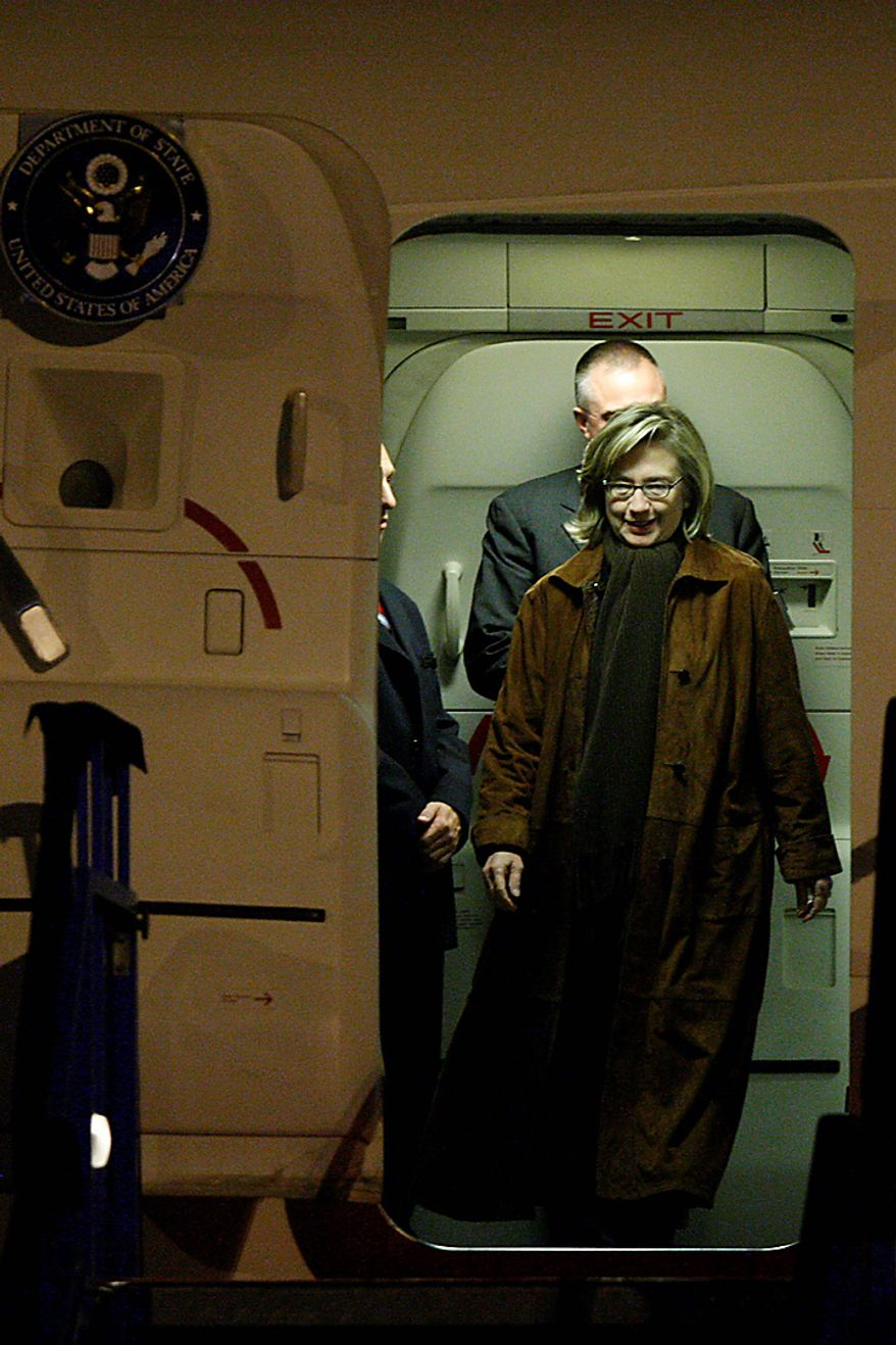 Secretary of State Hillary Rodham Clinton exits the aeroplane on her arrival in Sarajevo, Monday, Oct. 11, 2010. Secretary of State Hillary Rodham Clinton is pressing political reforms to the restive Balkans with the hope that such changes will lead to the region's full integration into the European Union and NATO. Secretary Clinton arrived late on Monday, in the capital of ethnically divided Bosnia-Herzegovina, which just held elections, to urge the country's new leadership to make EU membership a priority. (AP Photo/Amel Emric)