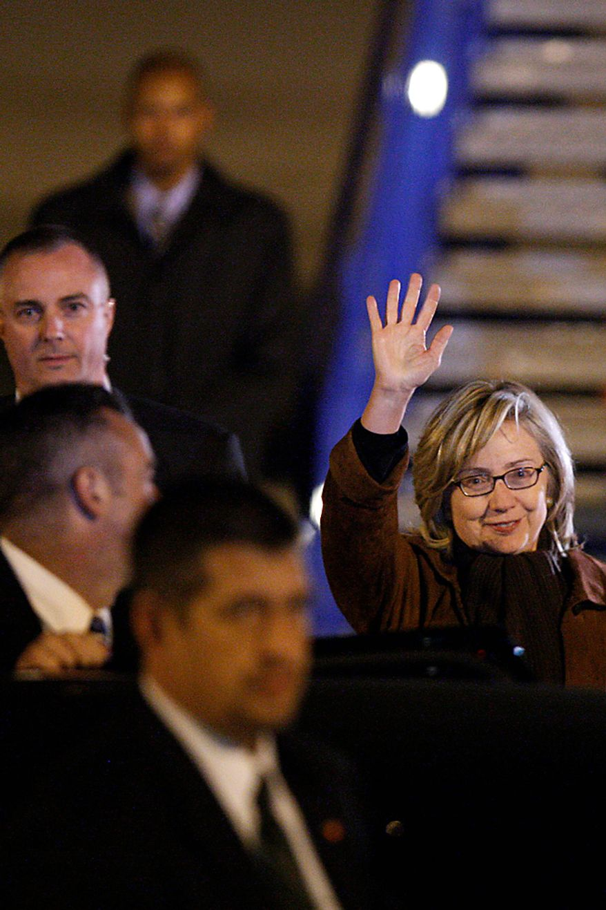 Secretary of State Hillary Rodham Clinton waves on her arrival in Sarajevo, Monday, Oct. 11, 2010. Secretary of State Hillary Rodham Clinton is pressing political reforms to the restive Balkans with the hope that such changes will lead to the region's full integration into the European Union and NATO. Secretary Clinton arrived late on Monday, in the capital of ethnically divided Bosnia-Herzegovina, which just held elections, to urge the country's new leadership to make EU membership a priority. (AP Photo/Amel Emric)