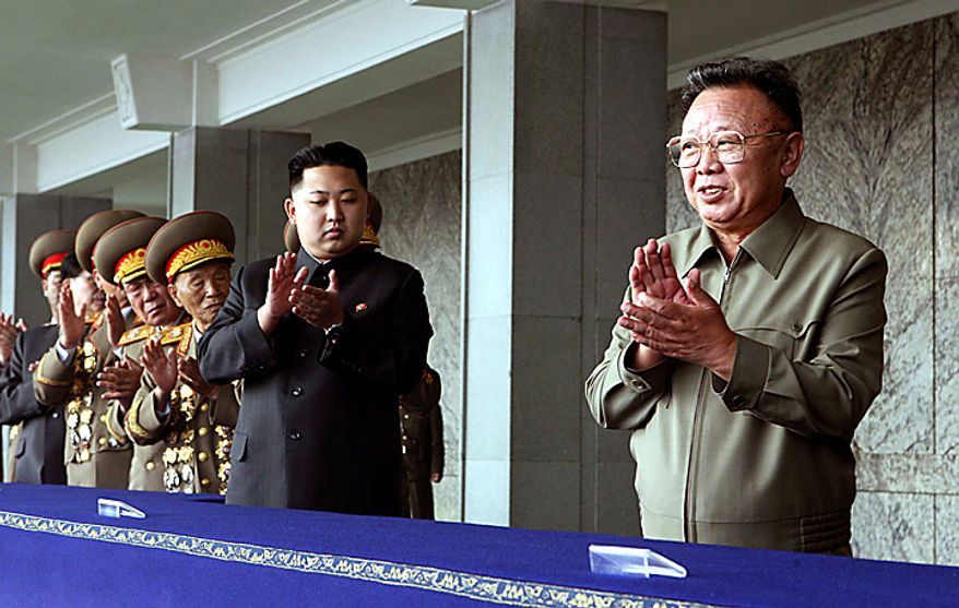 In this photo released by China's Xinhua News Agency, North Korean leader Kim Jong Il, right, and his third son Kim Jong Un, center, applaud before a massive military parade celebrating the 65th anniversary of the communist nation's Workers' Party,  in Pyongyang, North Korea, on Sunday,  Oct. 10, 2010. (AP Photo/Xinhua, Yao Dawei)