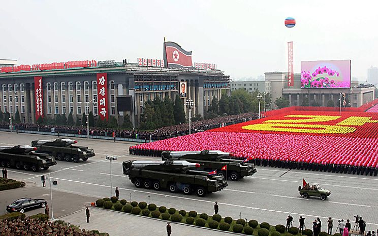 In this photo released by China's Xinhua news agency, North Korean missiles on the trucks make its way during a massive military parade to mark the 65th anniversary of the communist nation's ruling Workers' Party in Pyongyang, North Korea on Sunday, Oct. 10, 2010. This year's celebration comes less than two weeks after Kim Jong Il's re-election to the party's top post and the news that his 20-something son would succeed his father and