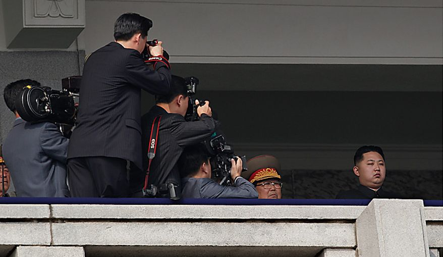 North Korea leader Kim Jong Il's son Kim Jong Un attend a massive military parade marking the 65th anniversary of the communist nation's ruling Workers' Party in Pyongyang, North Korea on Sunday, Oct. 10, 2010. This year's celebration comes less than two weeks after Kim Jong Il's re-election to the party's top post and the news that his 20-something son would succeed his father and grandfather as leader. (AP Photo/Vincent Yu)