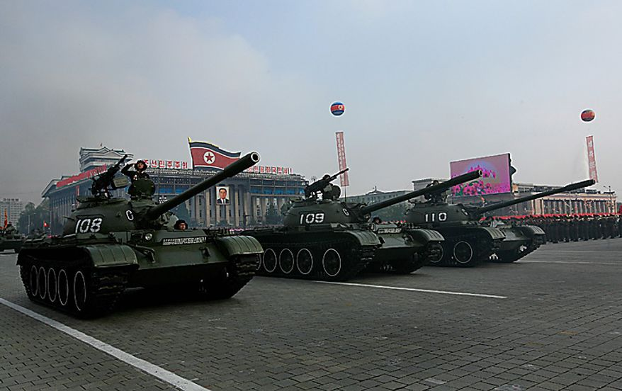 North Korean tanks are displayed during a massive military parade marking the 65th anniversary of the communist nation's ruling Workers' Party in Pyongyang, North Korea on Sunday, Oct. 10, 2010. This year's celebration comes less than two weeks after Kim Jong Il's re-election to the party's top post and the news that his 20-something son would succeed his father and grandfather as leader. (AP Photo/Vincent Yu)