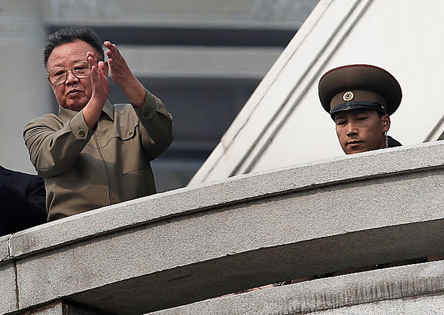 North Korean leader Kim Jong Il applauds following a massive military parade marking the 65th anniversary of the communist nation's ruling Workers' Party in Pyongyang, North Korea on Sunday, Oct. 10, 2010. This year's celebration comes less than two weeks after Kim's re-election to the party's top post and the news that his 20-something son would succeed him as leader. (AP Photo/Vincent Yu)