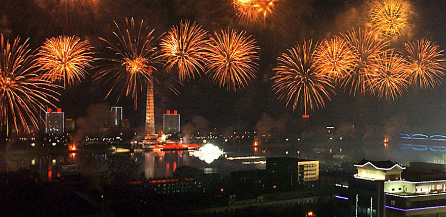 In this photo released by Korean Central News Agency via Korea News Service, fireworks explode during an evening celebration marking the 65th anniversary of North Korea's ruling Workers' Party in Pyongyang, North Korea on Sunday, Oct. 10, 2010. (AP Photo/Korean Central News Agency via Korea News Service)
