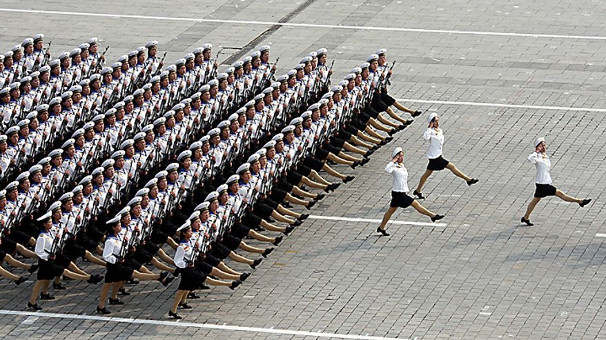 In this photo released by China's Xinhua news agency, North Korean women soldiers march during a massive military parade marking the 65th anniversary of the communist nation's ruling Workers' Party in Pyongyang, North Korea on Sunday, Oct. 10, 2010. This year's celebration comes less than two weeks after Kim Jong Il's re-election to the party's top post and the news that his 20-something son would succeed his father and grandfather as leader. (AP Photo/Xinhua, Yao Dawei)