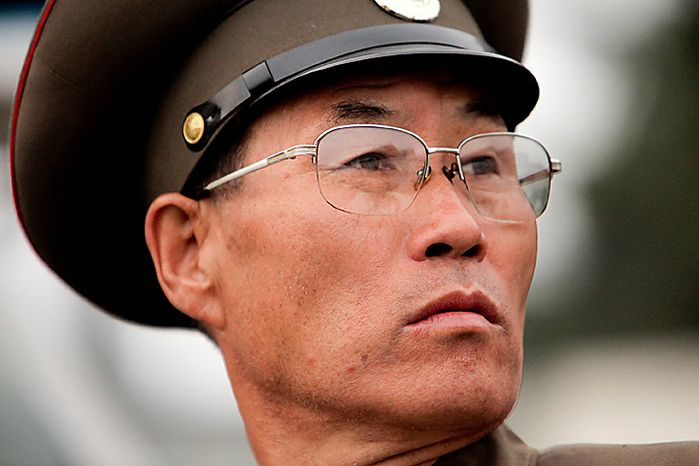 A member of the North Korean military attends a parade commemorating the 65th anniversary of the Korea Worker's Party in Pyongyang, North Korea, on Sunday, Oct. 10, 2010. North Korean heir apparent Kim Jong Un stood at his father's right side today as they reviewed troops, tanks and missiles in a Pyongyang military parade. Photographer: Dieter Depypere/Bloomberg