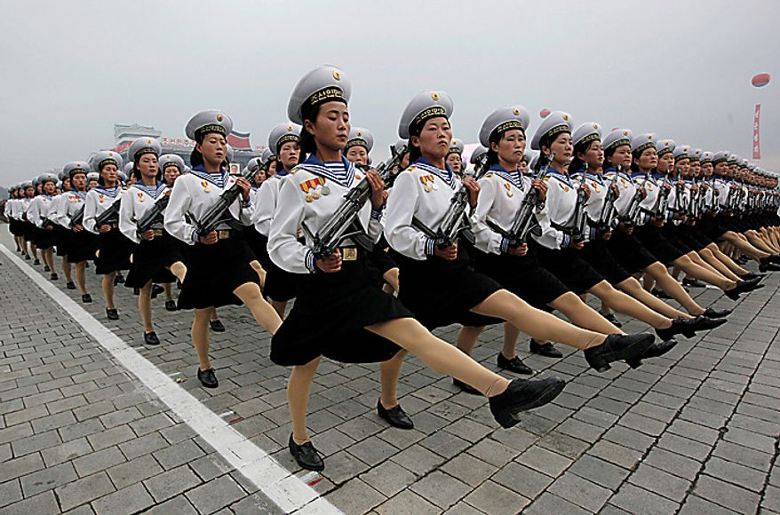 North Korean women soldiers practice matching before the biggest parade ever to mark the 65th anniversary of the communist nation's ruling Workers' Party in Pyongyang, North Korea on Sunday, Oct. 10, 2010. This year's celebration comes less than two weeks after North Korean leader Kim Jong Il's re-election to the party's top post and the news that his 20-something son would succeed his father and grandfather as leader. (AP Photo/Vincent Yu)
